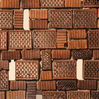 Old Brick Wall Full of Holes