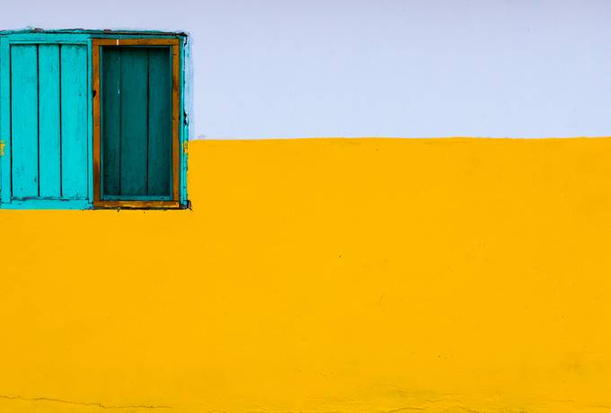 Yellow and White Wall with Turquoise Window