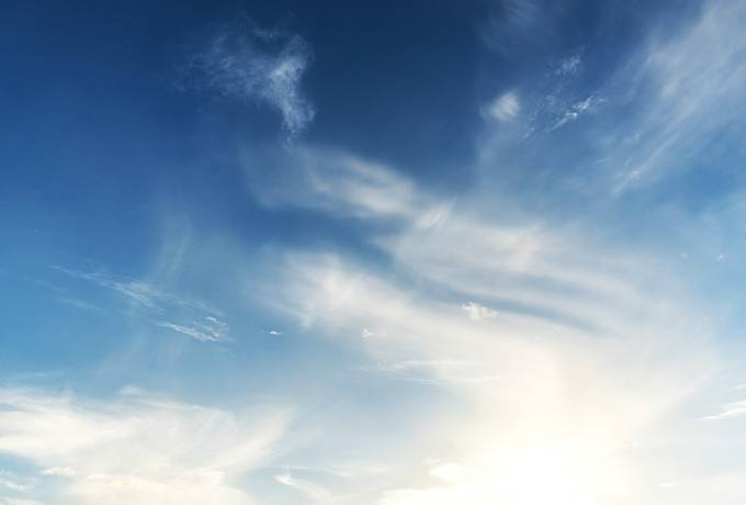 free Blue Sky with Clouds and Sunlight texture