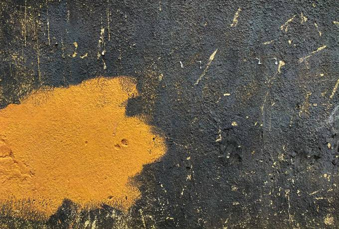 Black Wall with Yellow Stain