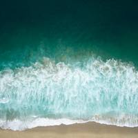 Aerial Drone Shot of Turquoise Sea at the Beach