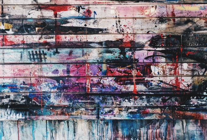 Grunge Colorful Paint on Wooden Plank Wall