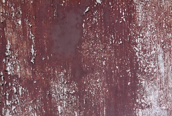 maroon metal peeling