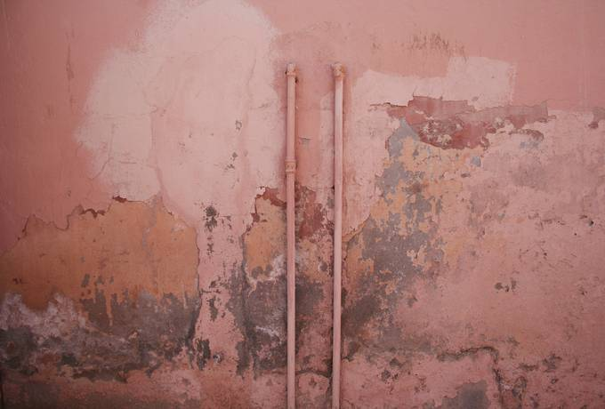 Dirty Pink Grunge Wall with Pipes