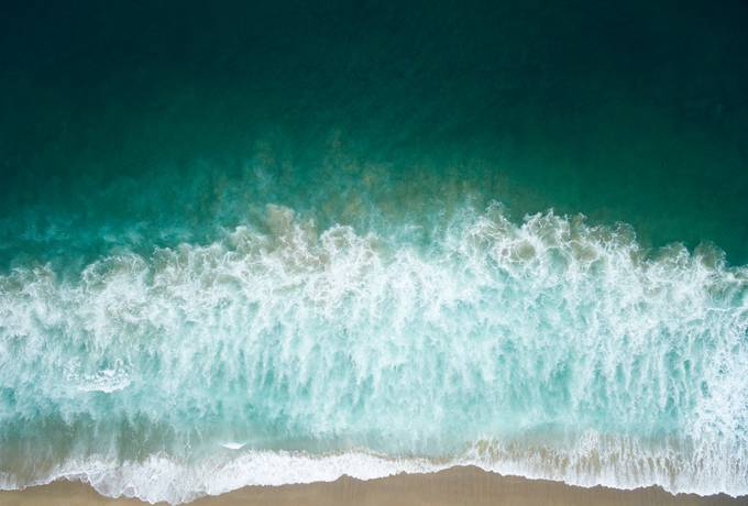 free Aerial Drone Shot of Turquoise Sea at the Beach texture