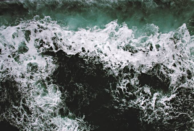 Rapid Sea with Foam and Green Water