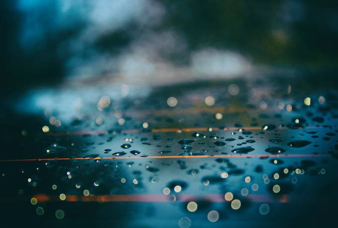 Bokeh Water Drops on Wet Surface