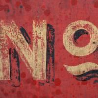 Retro No Inscription on Grunge Red Wall