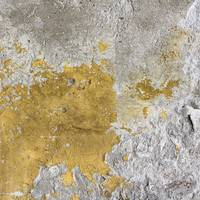 Old Cracked Yellow Plaster on the Cement Wall