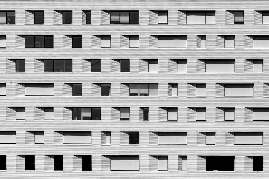 Windows on Gray Facade of a Building free texture