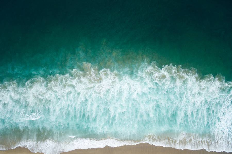 Aerial Drone Shot of Turquoise Sea at the Beach free texture
