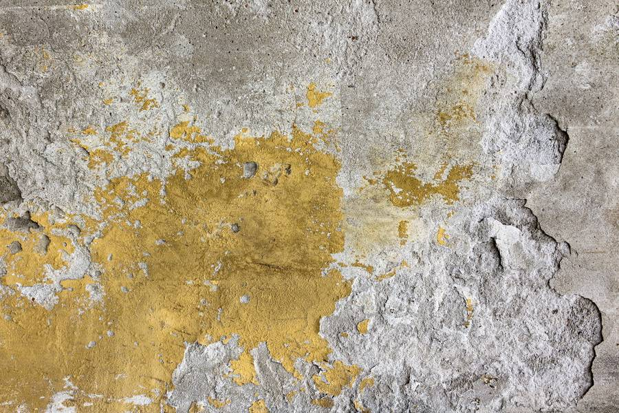 Old Cracked Yellow Plaster on the Cement Wall free texture